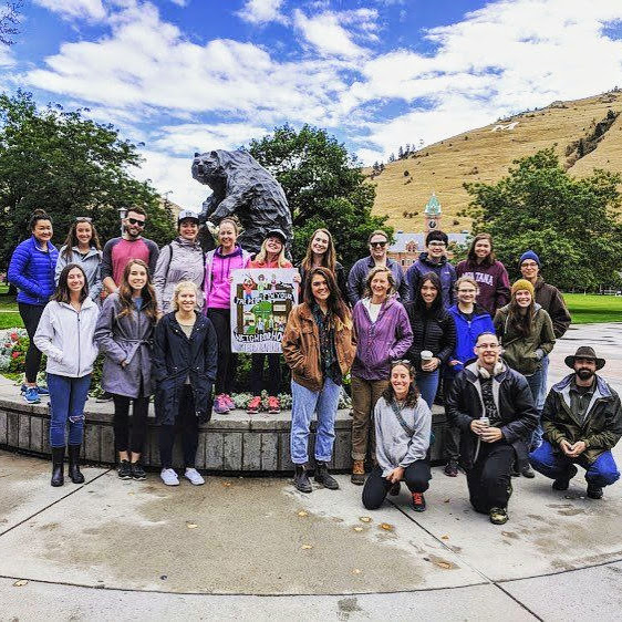 Sunday Sweepers participants in front of the Griz statue.