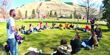 image of students attending class on oval