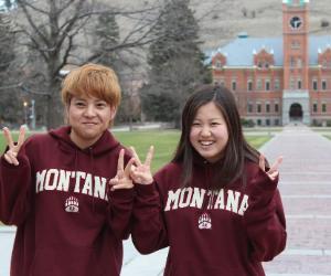 two international students in UM hoodies