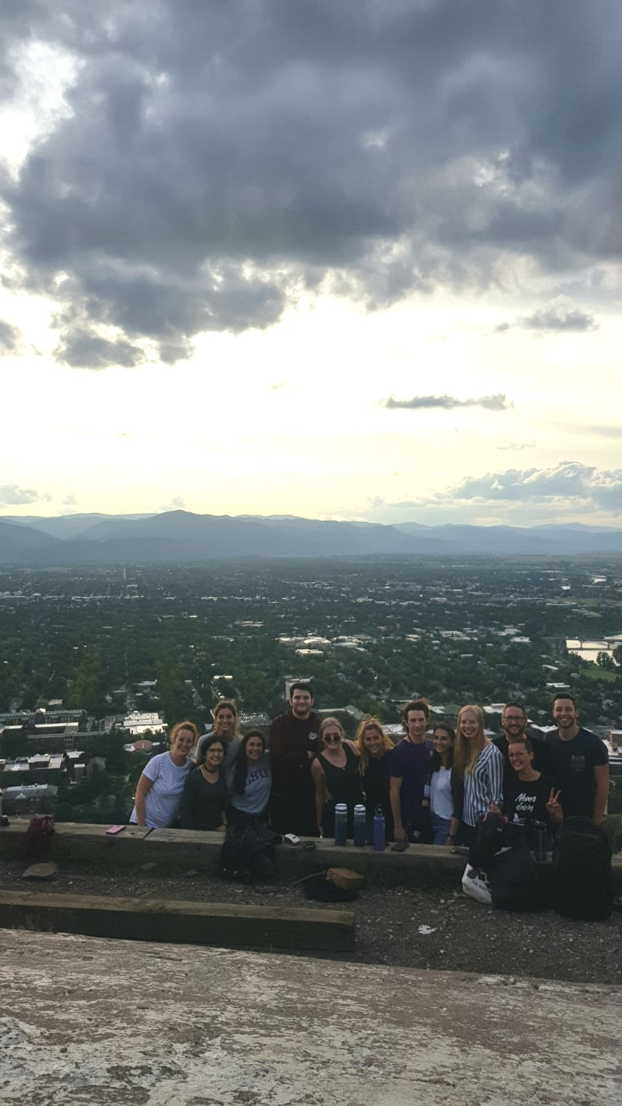 thirteen students on mount Sentinel with the city of Missoula in the back ground
