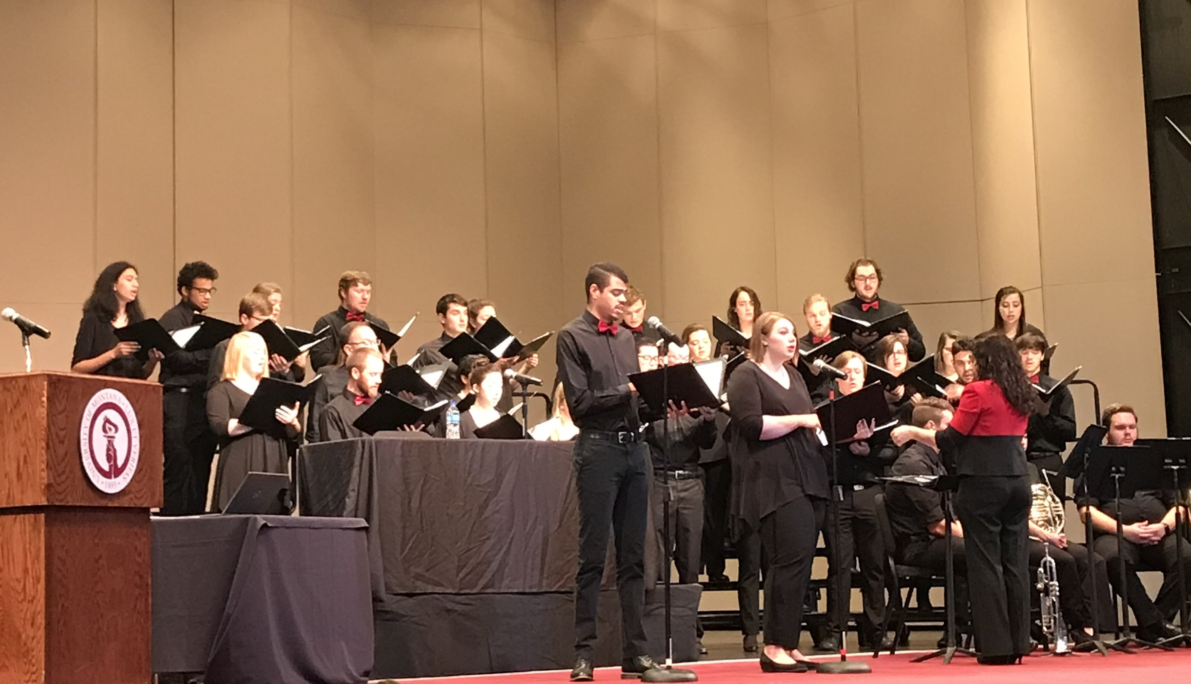 Students of the UM Chamber Chorale sing at the naturalization ceremony