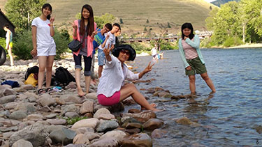 Summer programs students relax at the Clark Fork River