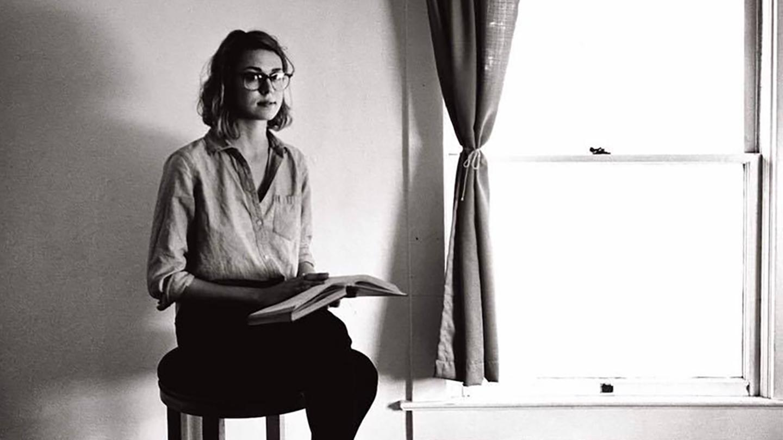 Portrait of Hope Ruskaup sitting on a stool