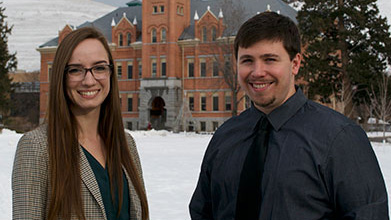 Portrait of Julia Goar and Nicholas Coombs in front of Montana Hall at the University of Montana