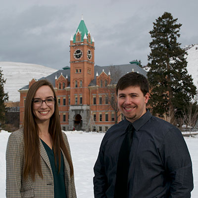 Photo of Julia Goar and Nick Coombs in front of Main Hall