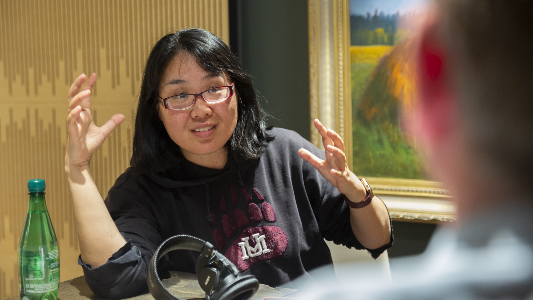 Photograph of Ke Wu talking with Ashby Kinch in the University of Montana College of Business' Studio 49