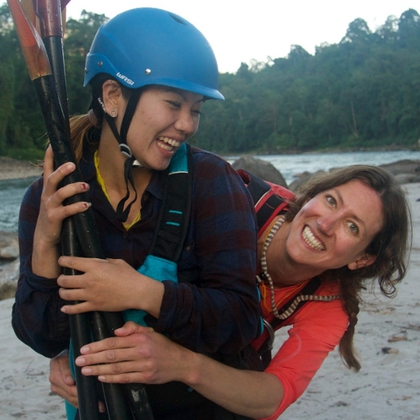 Kira Tenney in Bhutan with a female kayaker.