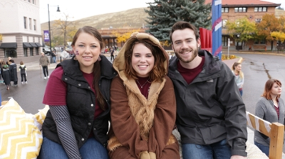 Image of three residence life student staff members on the Homecoming float.