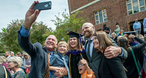 Family celebrating with graduate