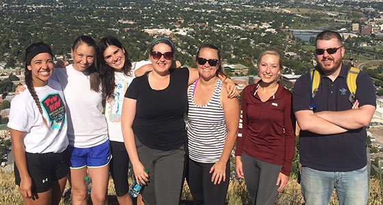 New and returning students hike the M trail