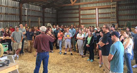 Students gather around a presenter