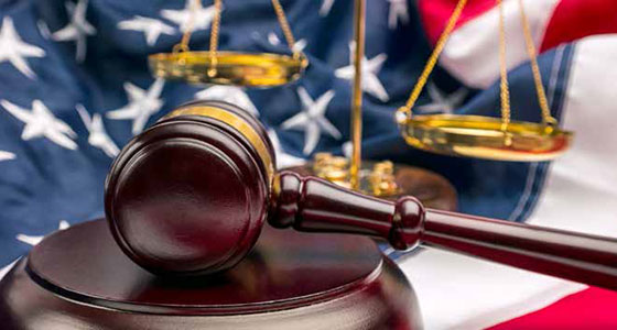 A gavel in front of the American flag
