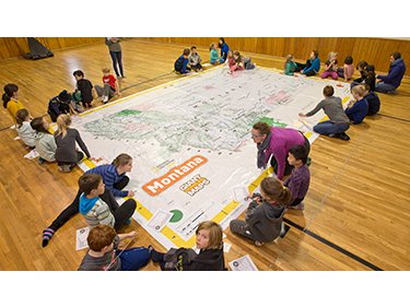 Sussex students interacting with giant Traveling Map of Montana