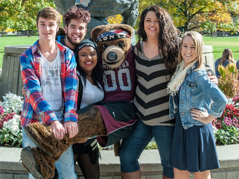 Students posing by the Bear with Monte