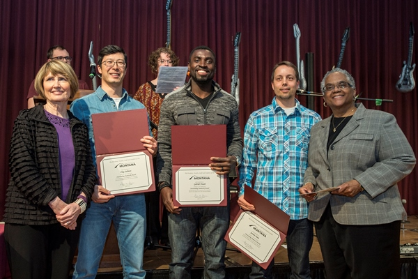 Gabriel Ansah, Oleg Salimov, and Jerome Steen pictures with President Sheila Stearns and Interim Provost Beverly Edmond