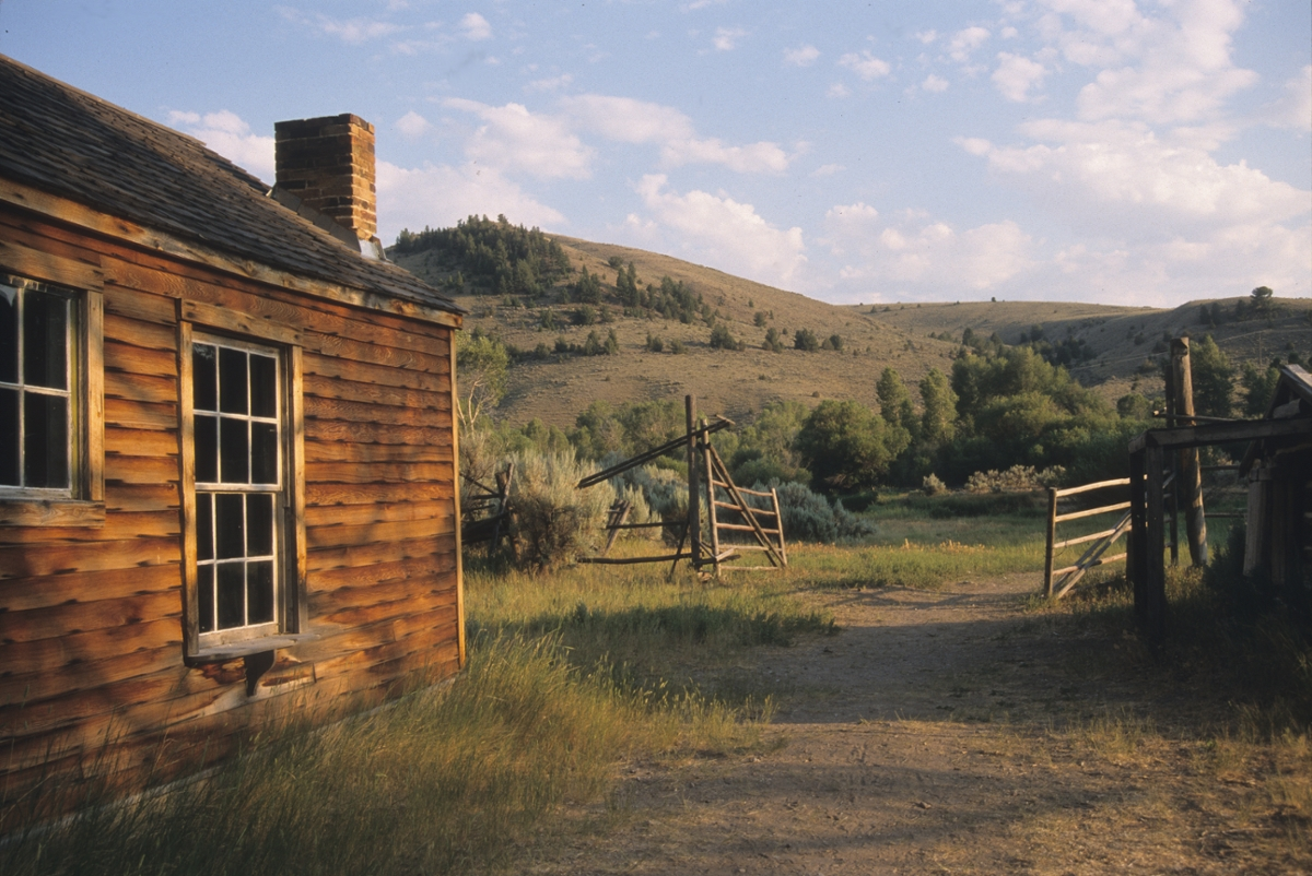 Sunlight illuminates a cabin in Bannack. (Photo by Rick and Susie Graetz)