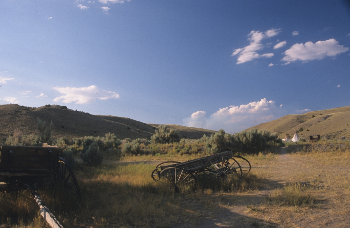 Wagons of a by-gone era stand silent in Bannack (Photo by Rick and Susie Graetz)