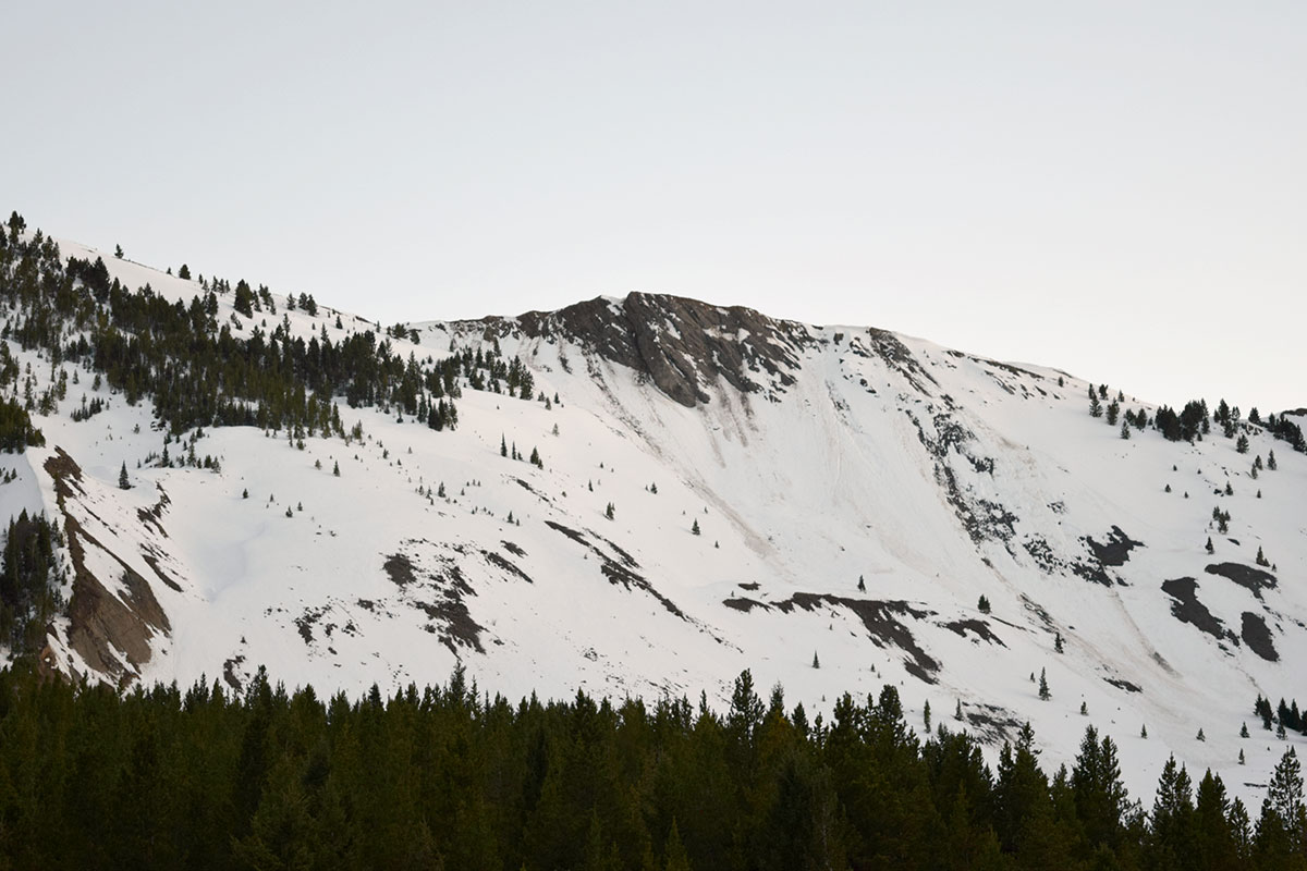 Snow covers the bare mountain side where the earthquake slide occurred in 1959