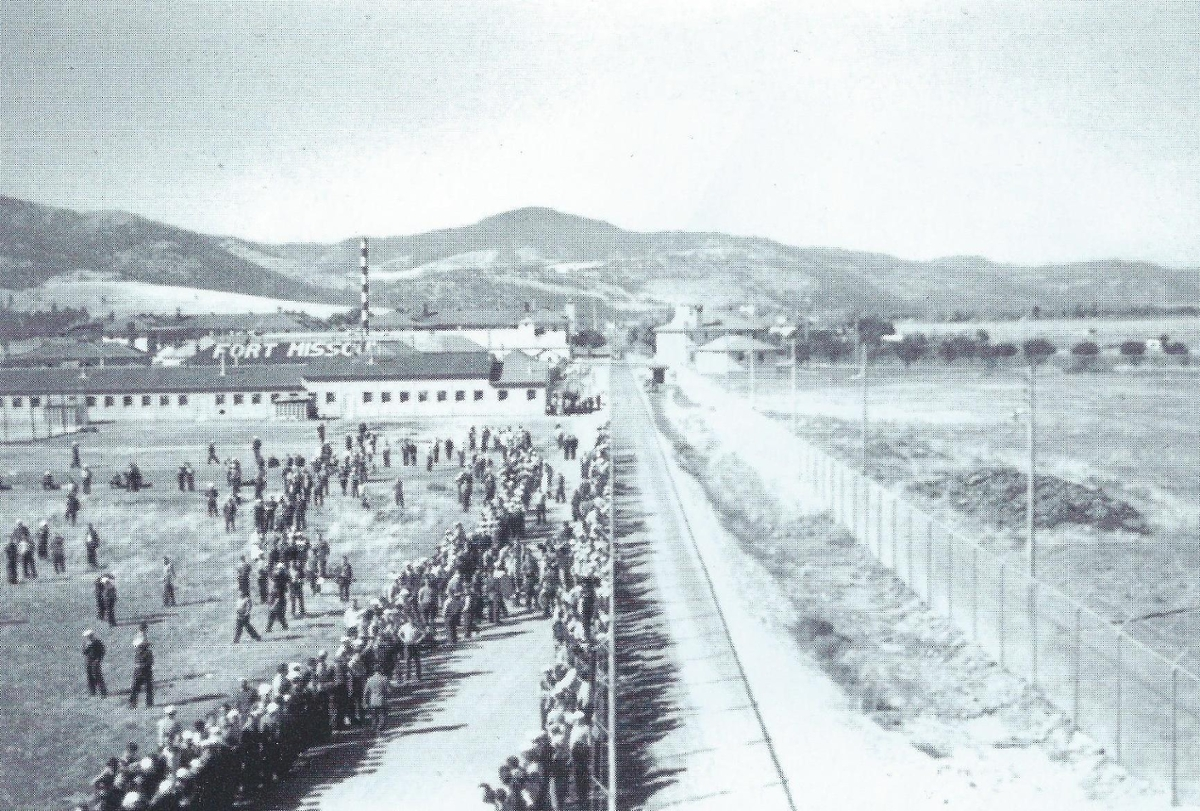 A large group of internment prisoners arrive at Fort Missoula.