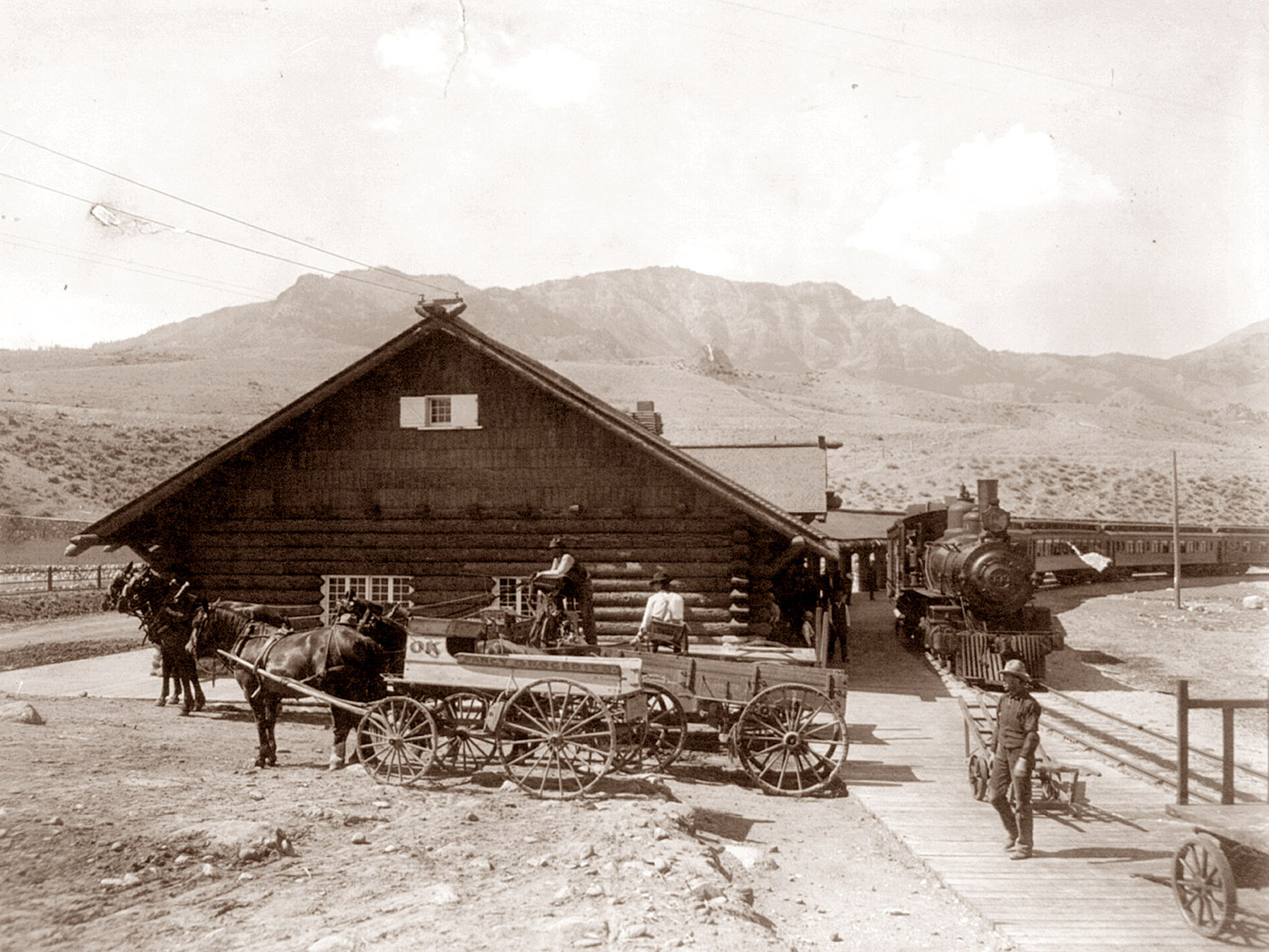 Old Railway Station: A locomotive and wagons parked at the old railway station in Gardiner (Montana Historical Society photo)