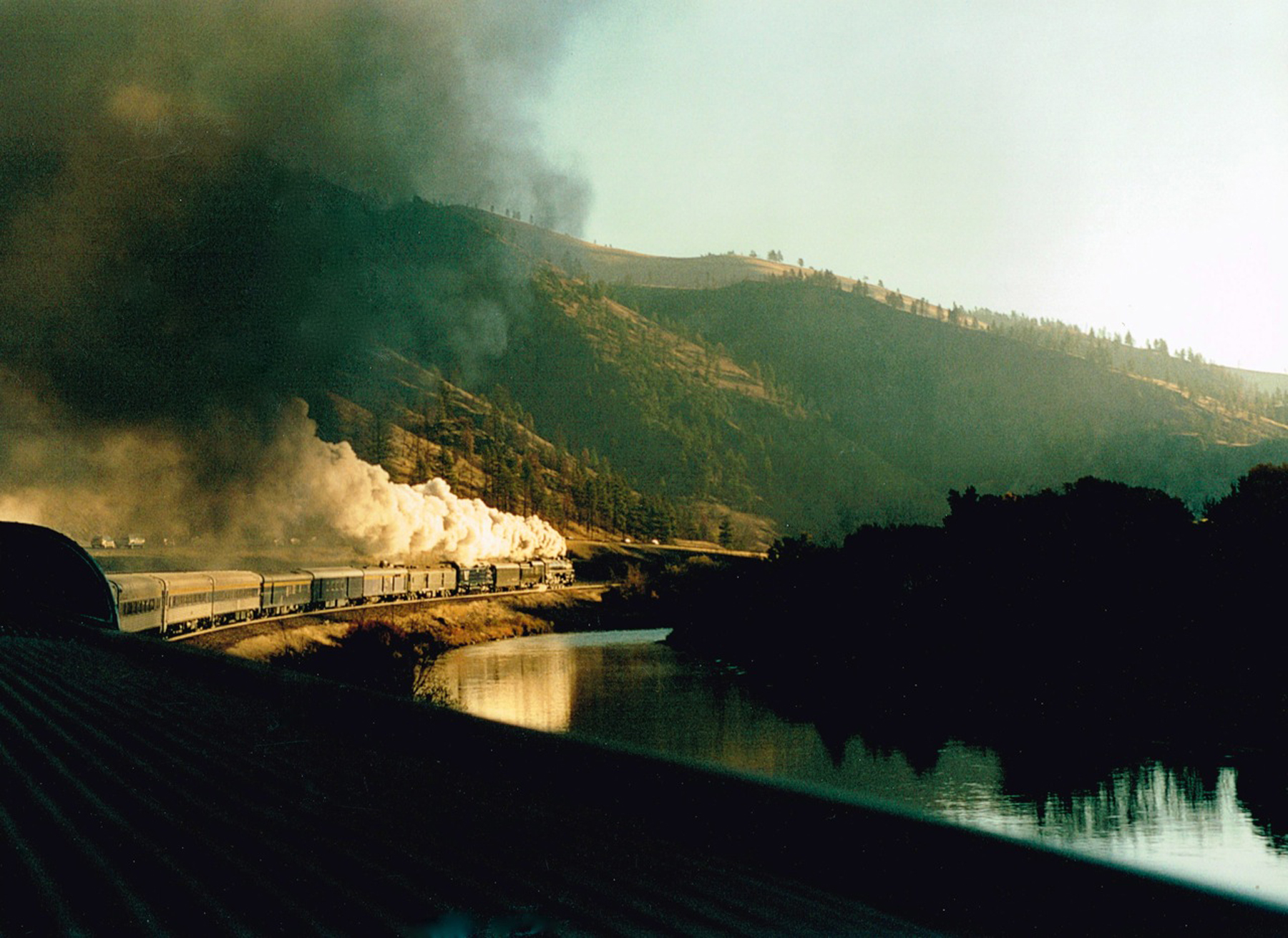 Train west of Drummond: The fully restored Spokane, Portland and Seattle Ry #700 travels west of Drummond in October 2002. (Photo by Jack Dykstra)