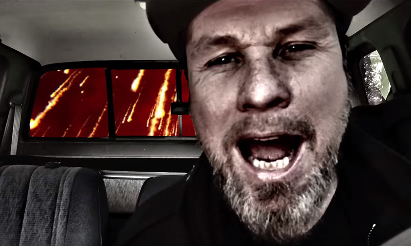 Screenshot of Ament's music video. Driving pickup as comets are seen from his rear window