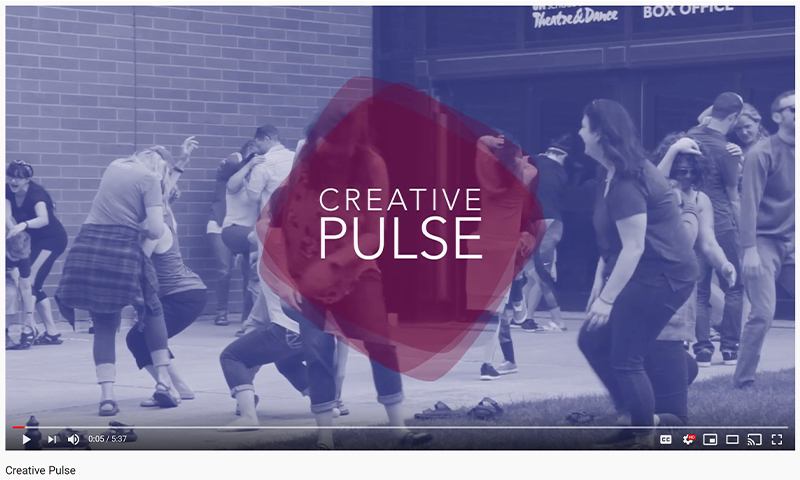 "screenshot of the title ""Creative Pulse"" appearing on screen over a video of students dancing and laughing"