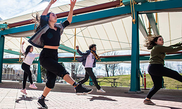 University of Montana students dance in Caras Park. Sara Diggins for the Missoulian